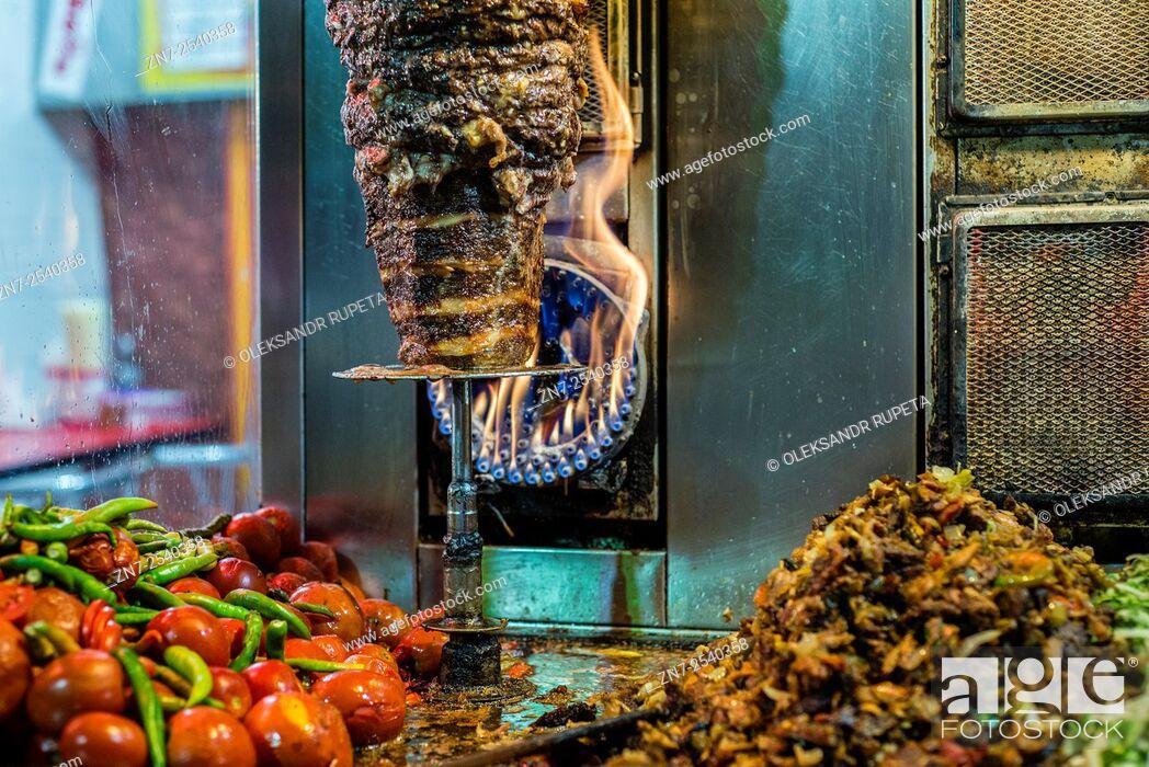 Stock Photo: Kebab meat on rotisserie in Tehran, Iran.