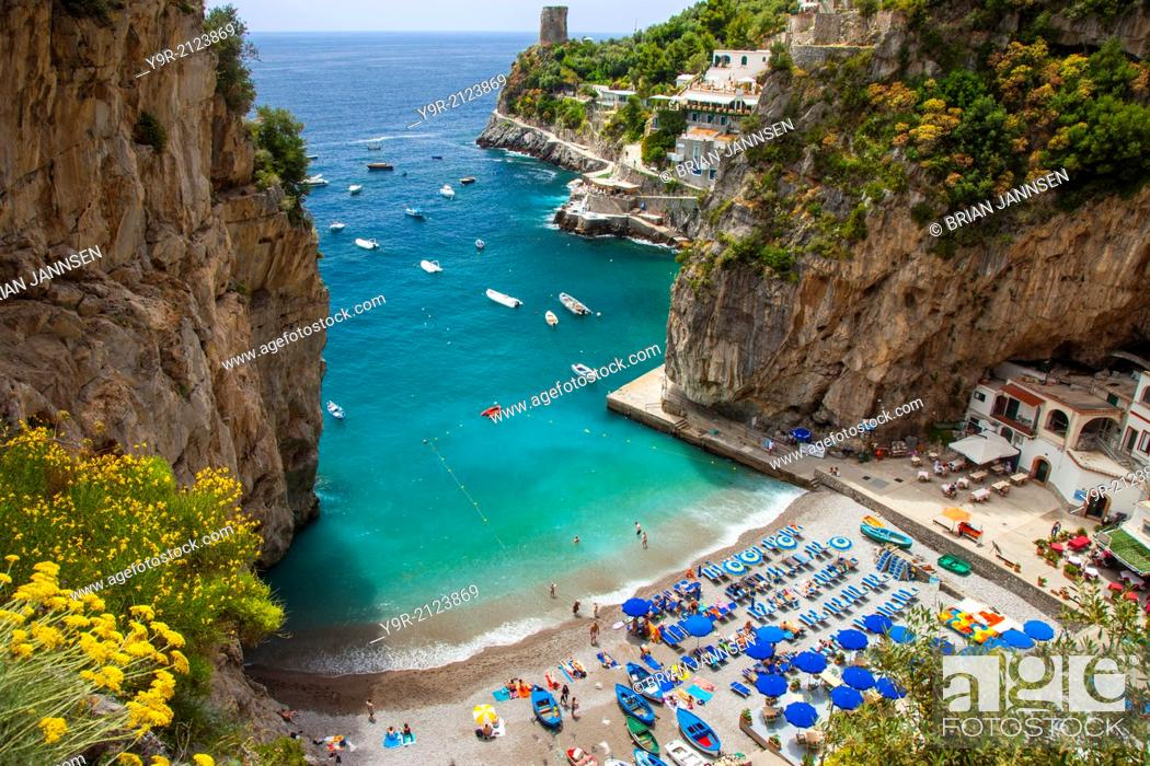Stock Photo: Tiny beach in the rocky coastline of Amalfi near Praiano, Campania Italy.