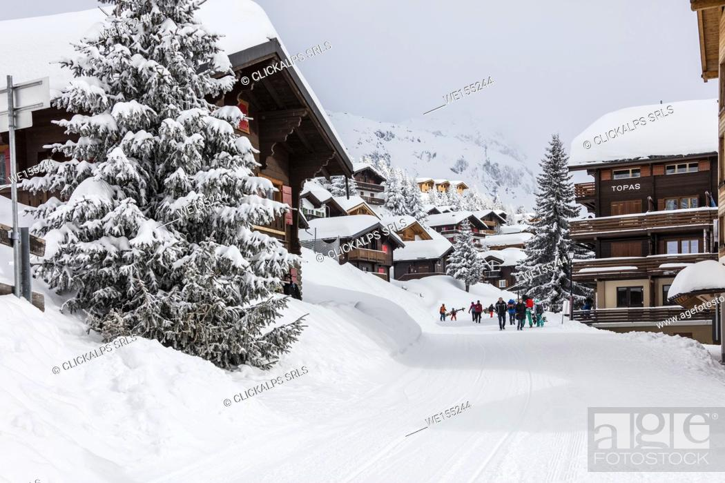 Stock Photo: Tourists in the alpine village surrounded by snow and woods Bettmeralp district of Raron canton of Valais Switzerland Europe.