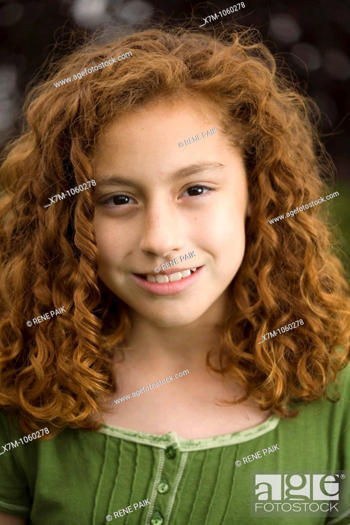 Stock Photo: Smiling young red-headed girl  Mixed race, Mexican and caucasian.