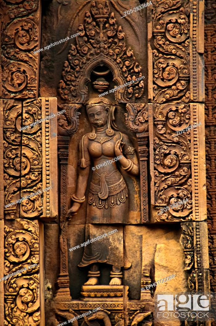Stock Photo: Devata carving, Banteay Srei temple, Angkor, Cambodia. The citadel of women, this temple contains the finest, most intricate carvings to be found in Angkor.