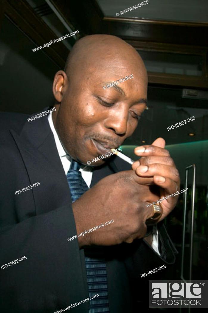 Stock Photo: Businessman smoking a cigarette.