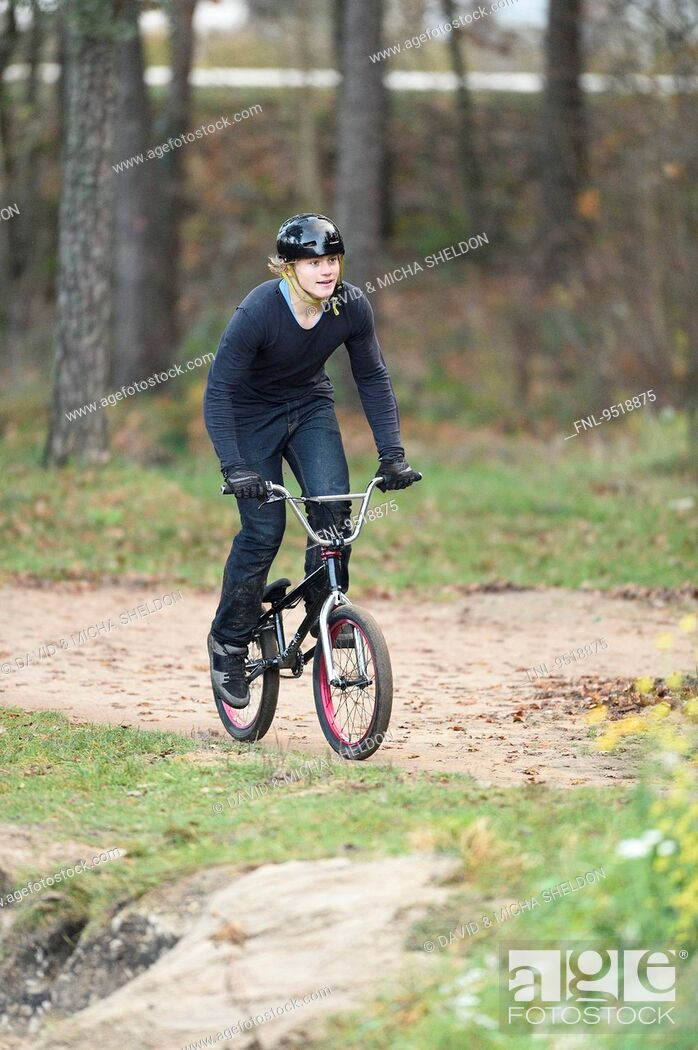 Stock Photo: Teenager with bmx bike in forest.