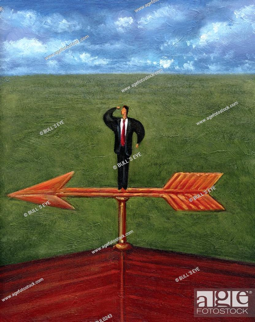 Stock Photo: Businessman looking out into the distance while standing on the arrow of a weathervane.
