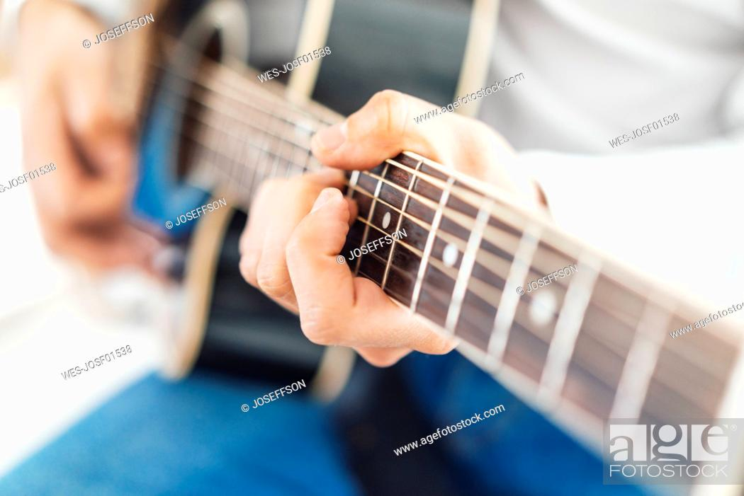 Stock Photo: Man with acoustic guitar, close up.