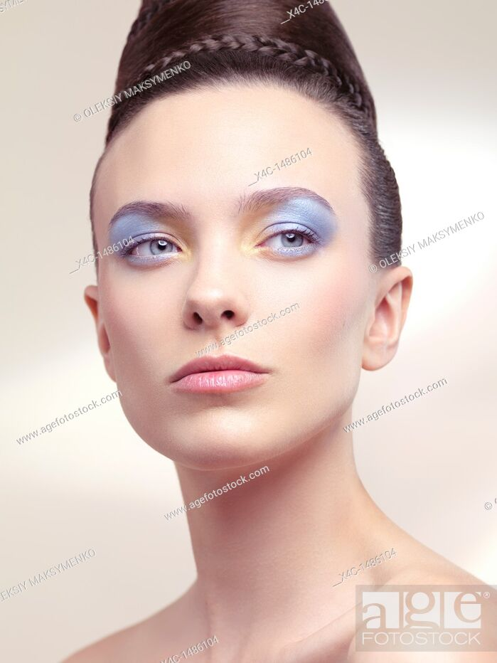 Stock Photo: Beauty portrait of a young woman with soft pastel color makeup and beautiful hairstyle.