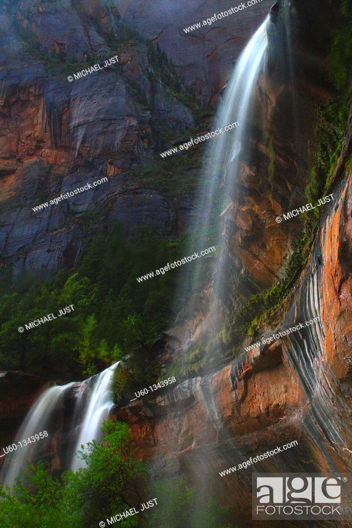 Stock Photo: Three waterfalls are produced during a heavy rain at The Emerald Pools at zion National Park,Utah.