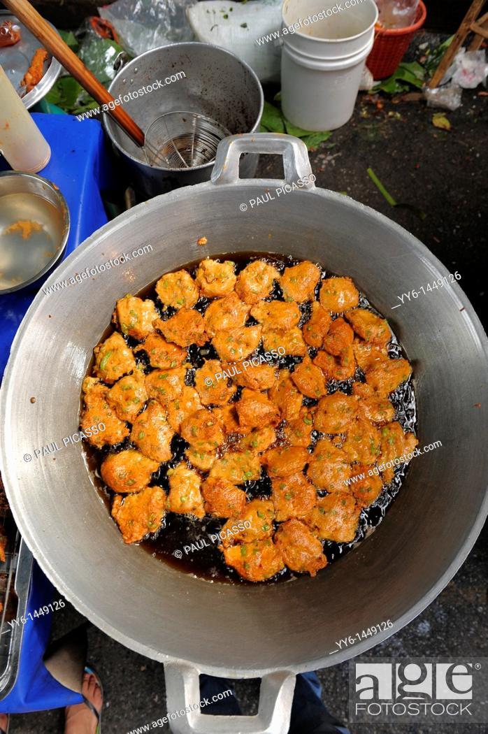 Stock Photo: thai fish cakes being cooked , street market , bangkok, thailand.