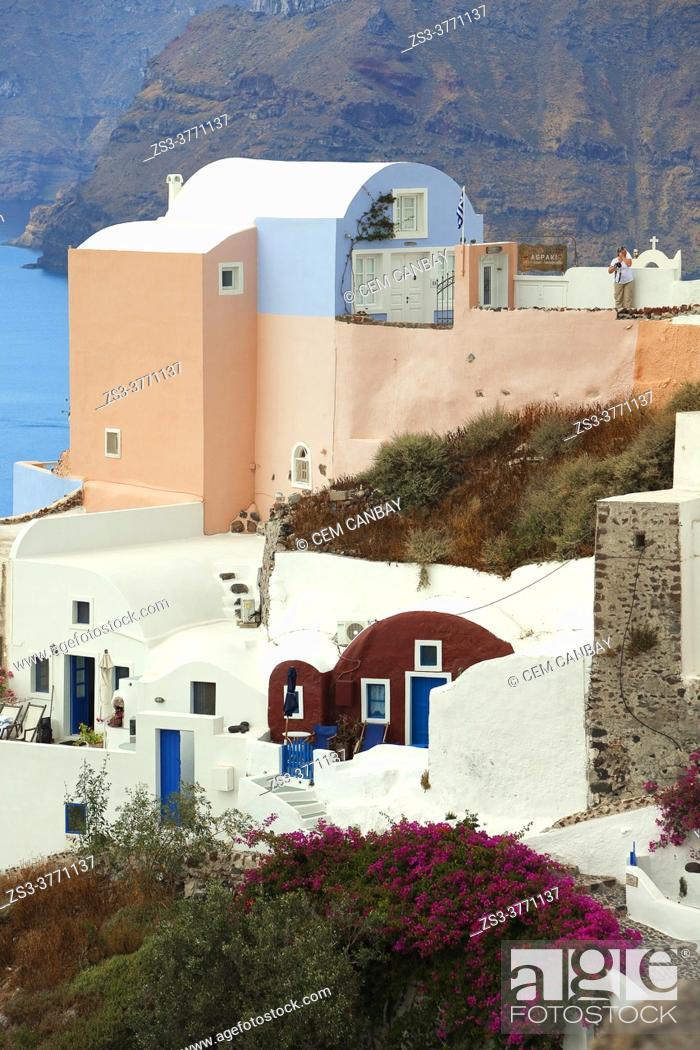 Stock Photo: Traditional houses in Oia village, Santorini Island, Cyclades Islands, Greek Islands, Greece, Europe.
