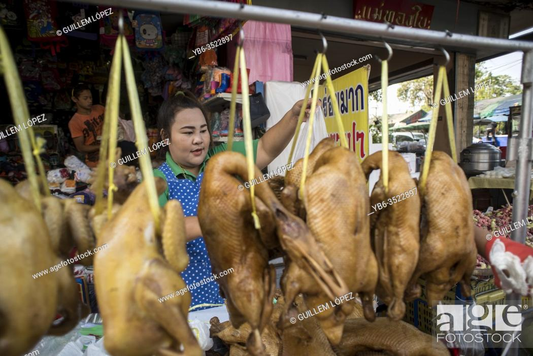 Stock Photo: A cooked duck seller at the Samut Sakhon market, Bangkok, Thailand.