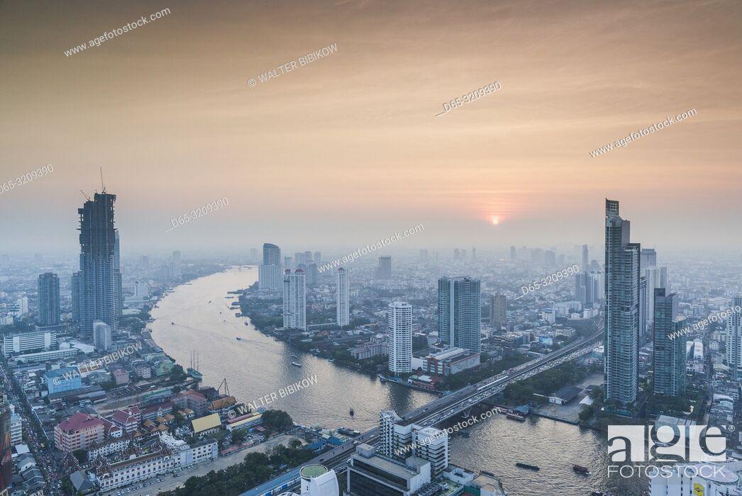 Stock Photo: Thailand, Bangkok, Riverside Area, high angle city skyline by Chao Phraya River, dusk.