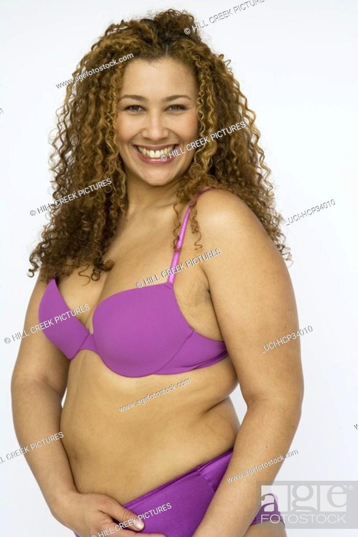 Stock Photo: Woman smiling wearing bra and panties.