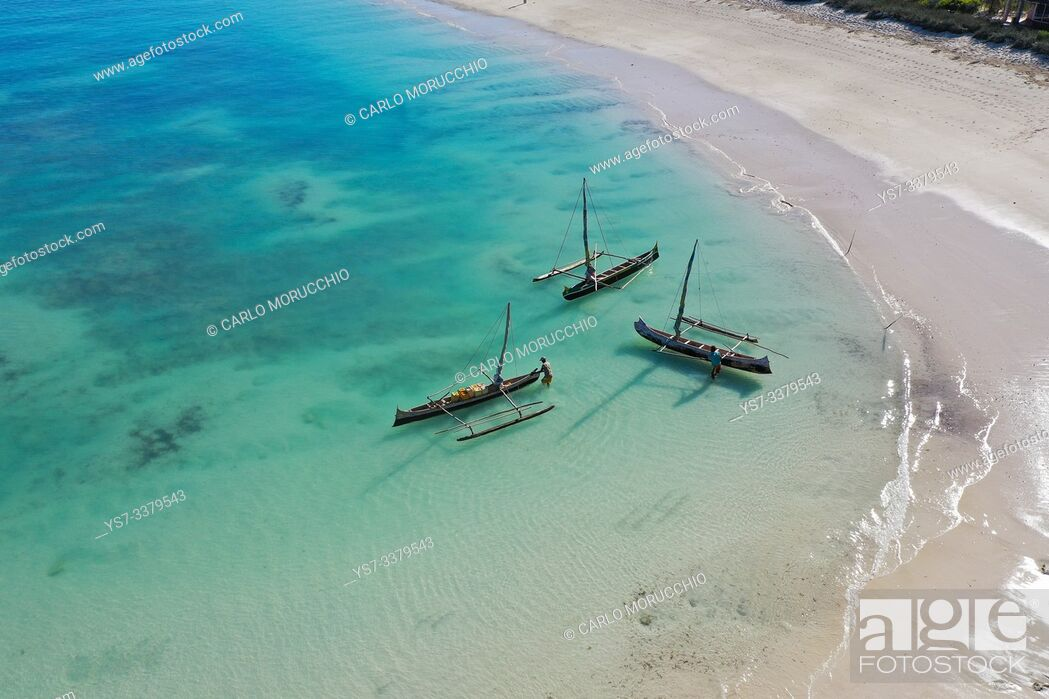 Stock Photo: outrigger boats on the coral reef near Salary, South Western coast of Madagascar.