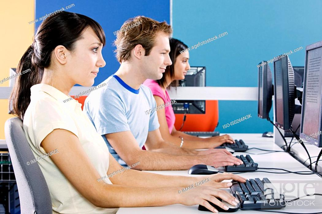 Stock Photo: Students in computer room.