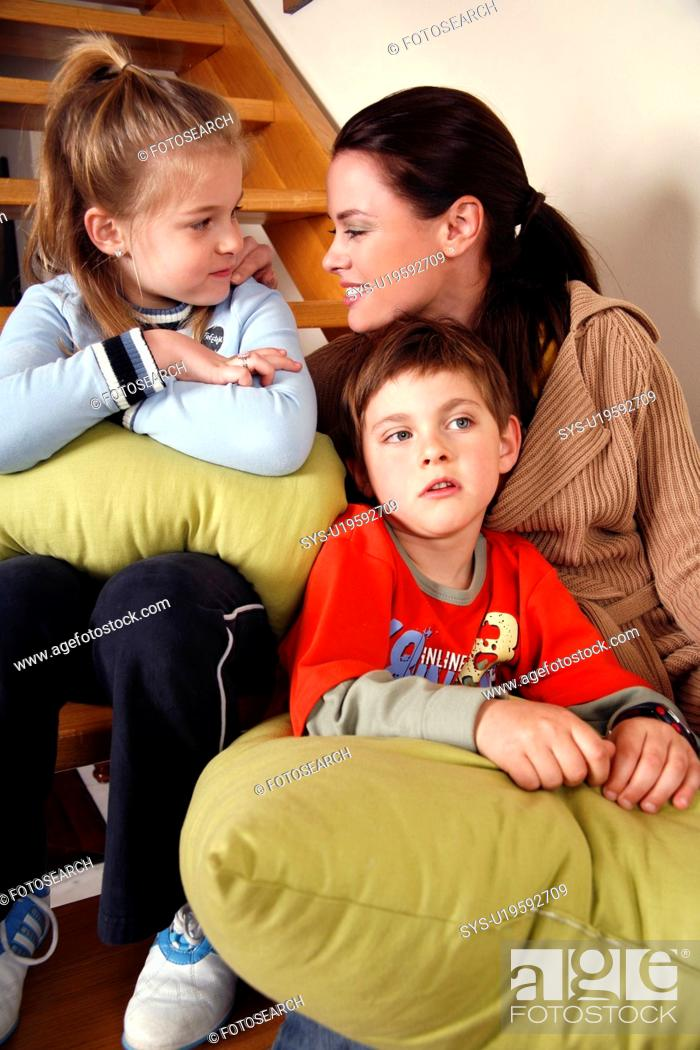 Stock Photo: Mother with tired children on staircase.