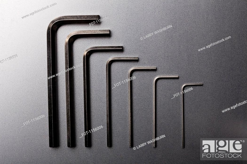 Stock Photo: Various sizes of Allen wrenches in a neat row.