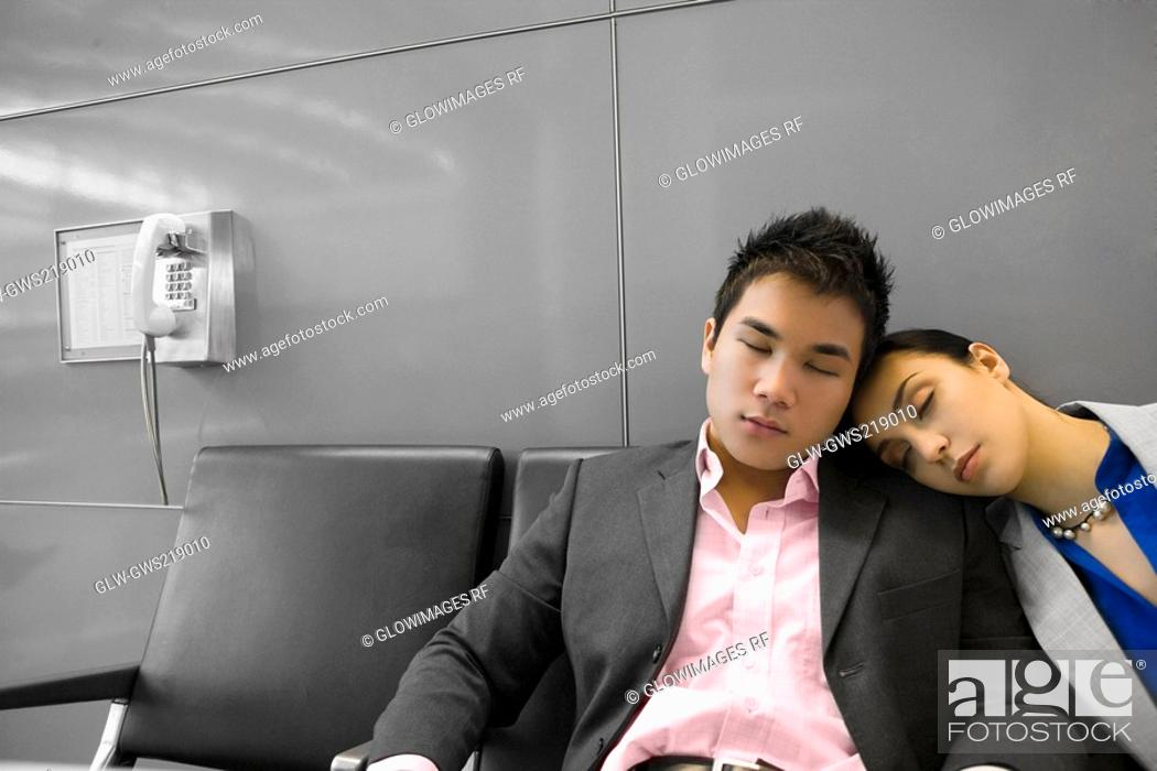 Stock Photo: Businessman and a businessman sleeping in the waiting room.