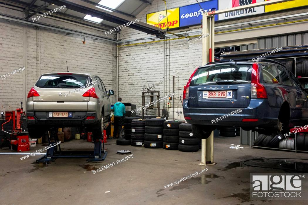 Cars On Ramp Waiting For Summer Tyres Being Changed For Winter Tires In Tire Centre Stock Photo Picture And Rights Managed Image Pic Plp 131114p008 Agefotostock