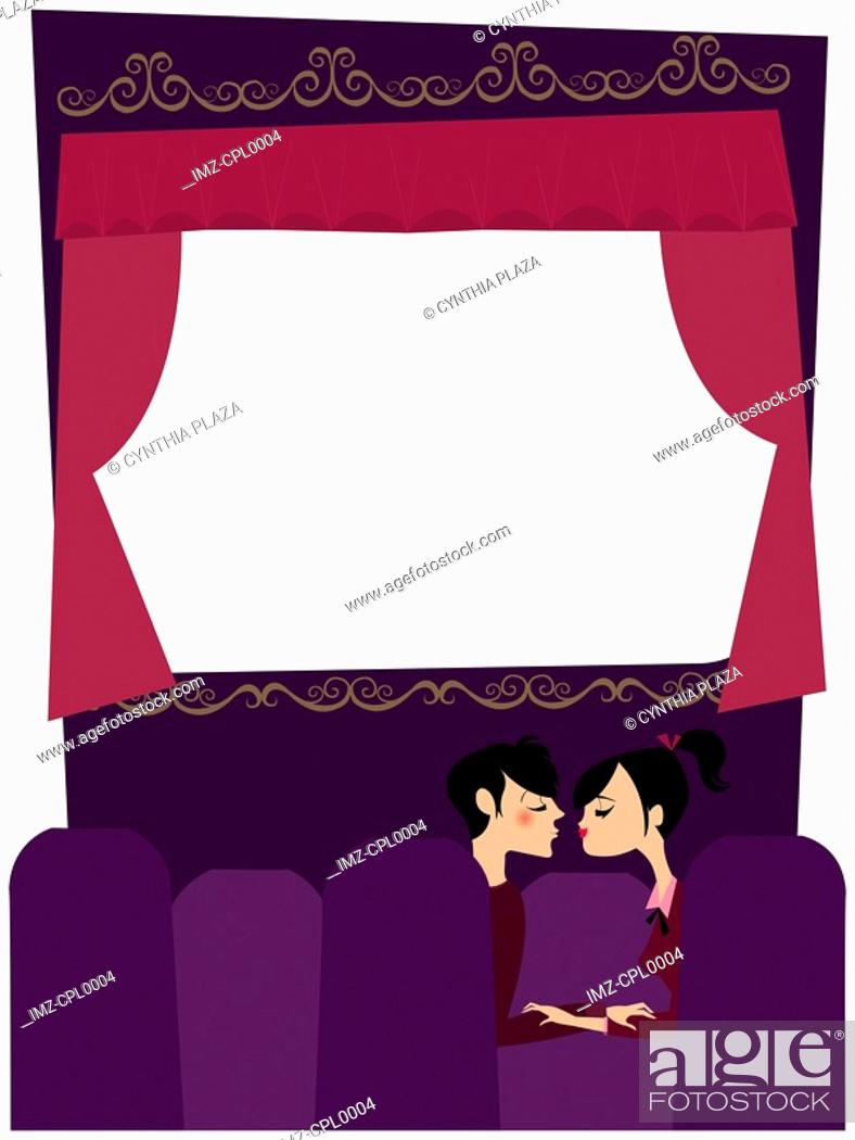 Stock Photo: A couple kissing in a movie theater.