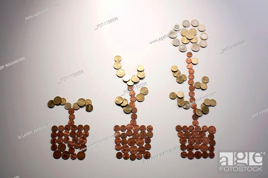 Stock Photo: European Union coins arranged to the shape of a flower in three stages of growth.