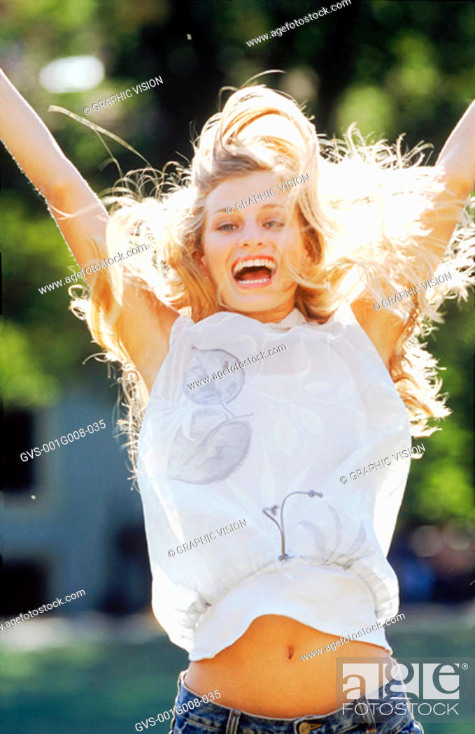 Photo de stock: Close-up of a woman jumping with excitement.