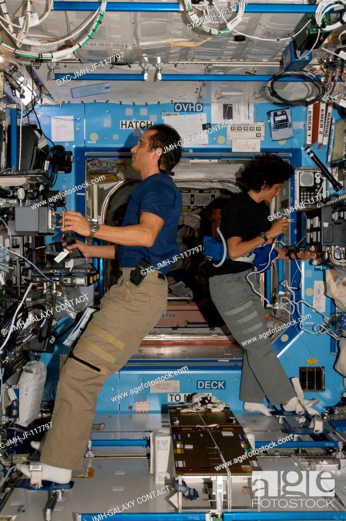Stock Photo: NASA astronauts Joe Acaba and Sunita Williams, both Expedition 32 flight engineers, work in the Destiny laboratory of the International Space Station.