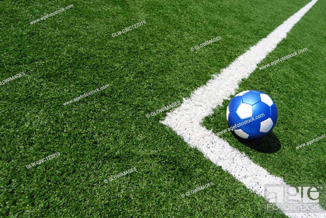 Stock Photo: High angle view of a soccer ball near a yard line.