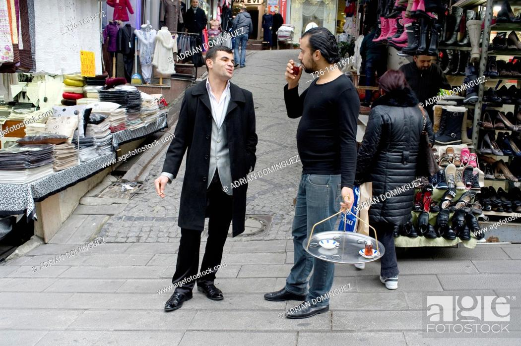 Stock Photo: Two men talking in the Grand Bazar of Istanbul city, Turkey.