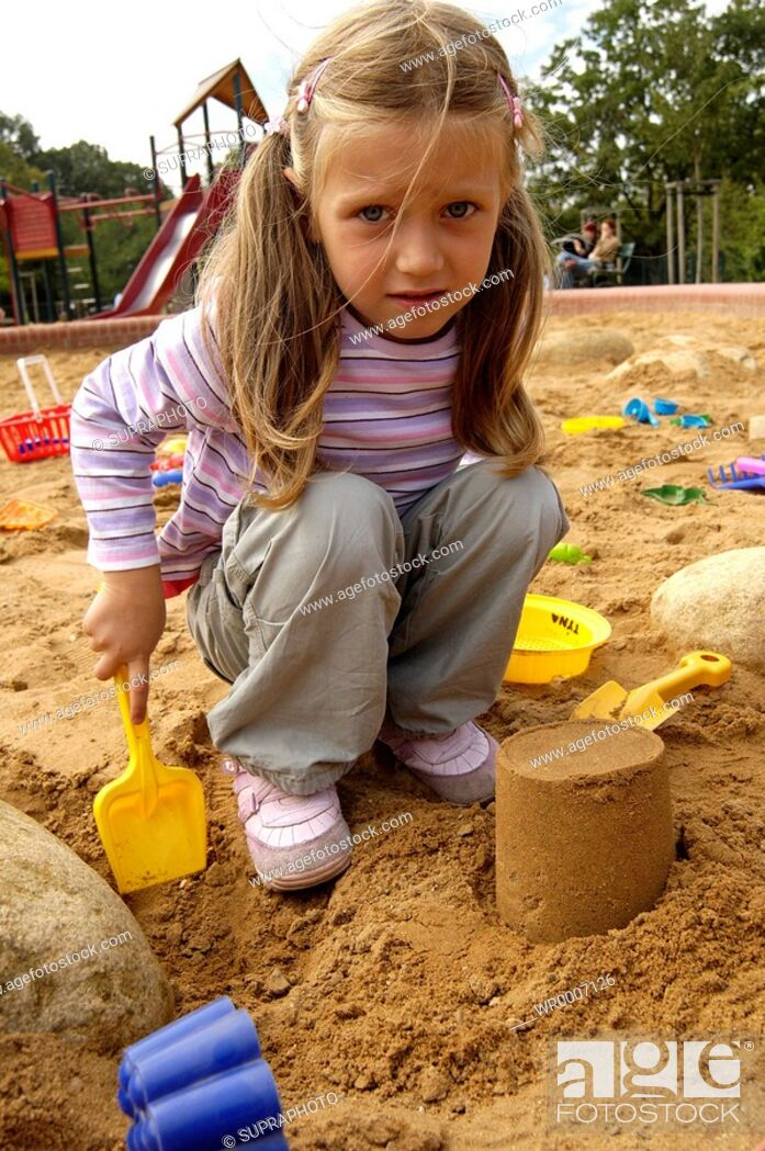Stock Photo: Color Image, People, Sand, Nature, Child, Kid, Girl, Toy, Object, Coloured, Colorful, Character, Place, Pink, Clothing, T-Shirt, Trousers, Garment, Colors