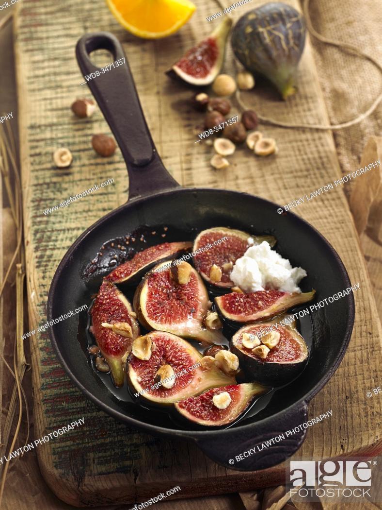 Stock Photo: higos asados / roasted figs.