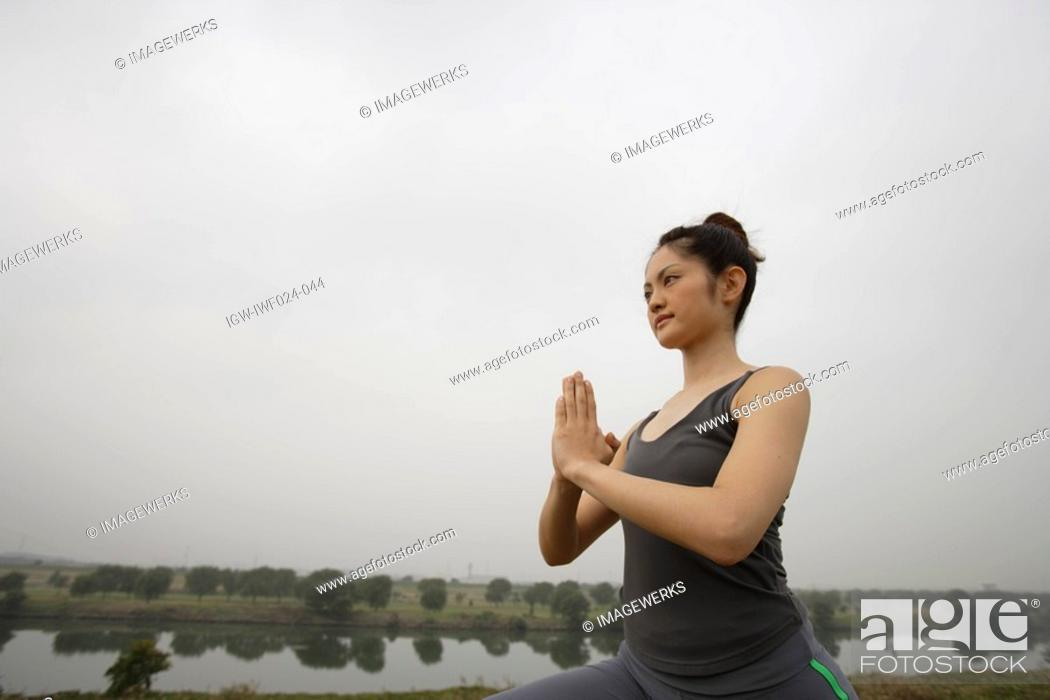 Stock Photo: View of a young woman performing yoga.