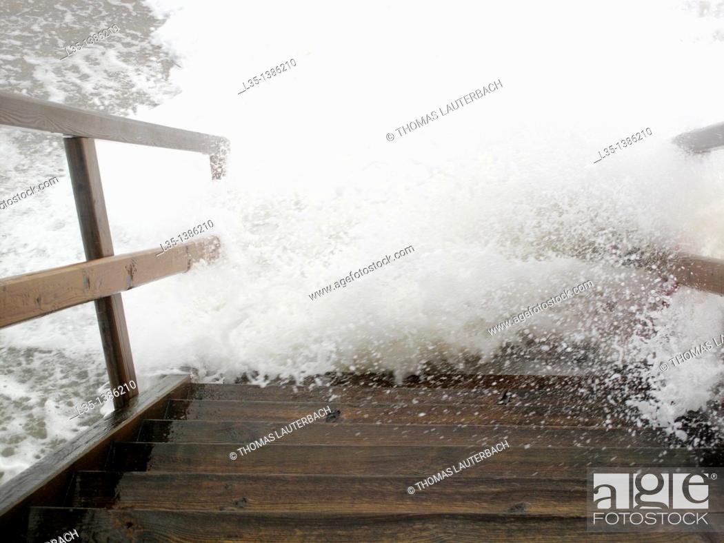 Stock Photo: Stairs at the sea of roaring waves recorded, Sylt, Germany.