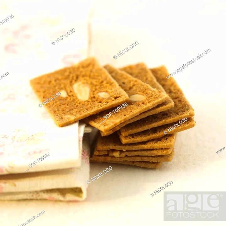 Stock Photo: Pile of square almond biscuits.