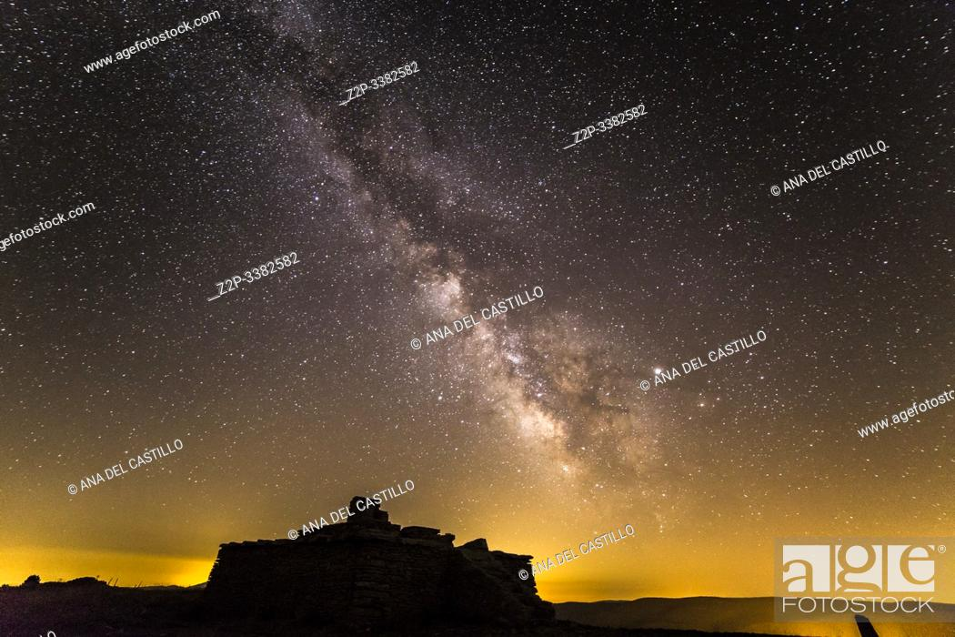 Stock Photo: Milky way over night pollution and mountains in Valdelinares over 2000 meters high view point Teruel Aragon Spain Starlight spot.