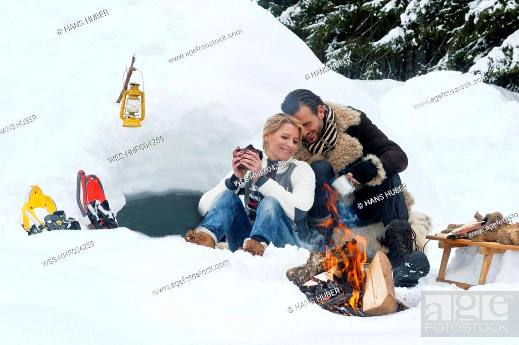 Stock Photo: Austria, Salzburg County, Couple sitting near fireplace.