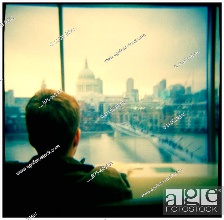 Stock Photo: St. Paul's cathedral & Millenium Bridge from Tate Modern, river Thames, London. England, UK.