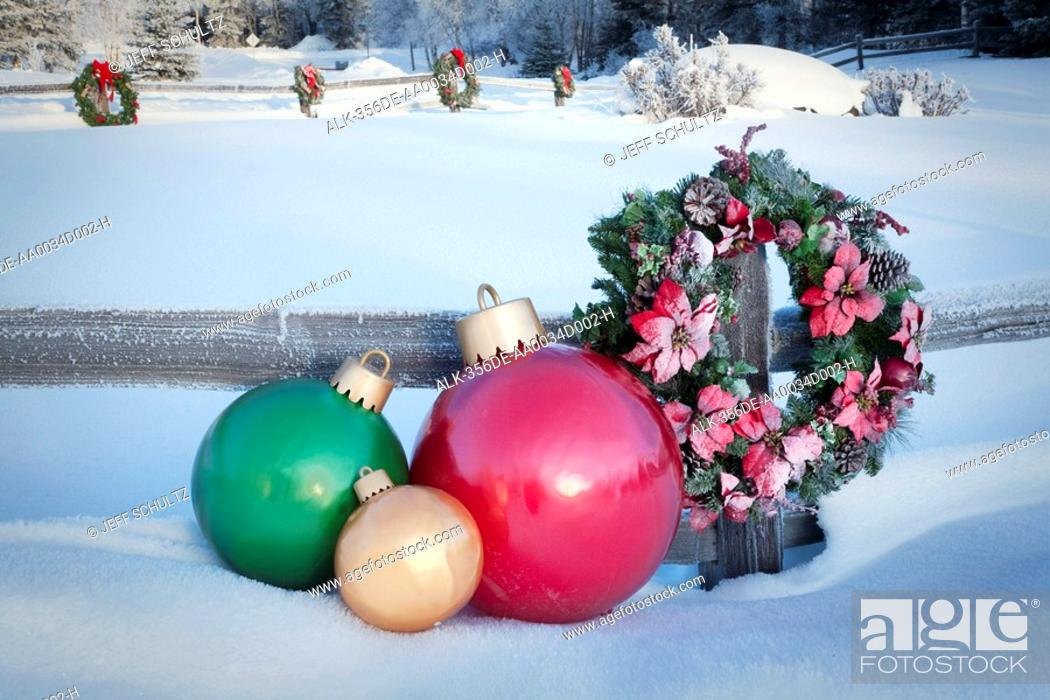 stock photo split rail fence decorated with christmas wreaths and decorations anchorage southcentral - Christmas Fence Decorations