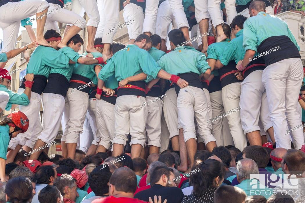 Stock Photo: Castell, human tower built in festivals, Vilafranca del Penedes, province Barcelona, Catalonia, Spain.