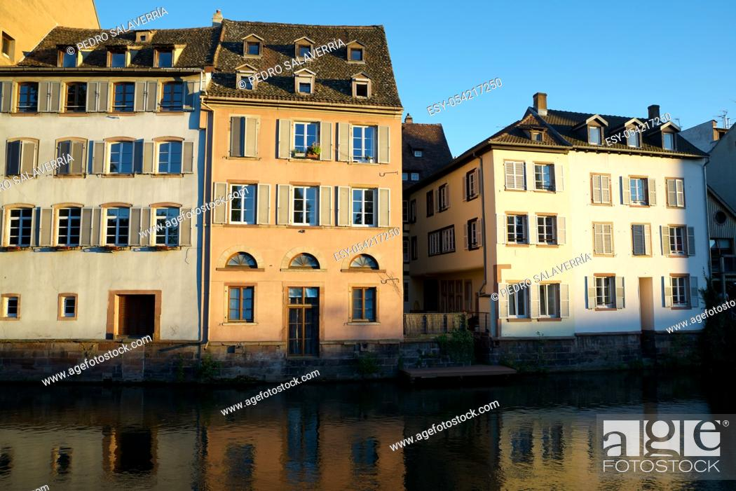 Stock Photo: Facade of a typical house and canal in the old town of Strasbourg, Alsace, France.