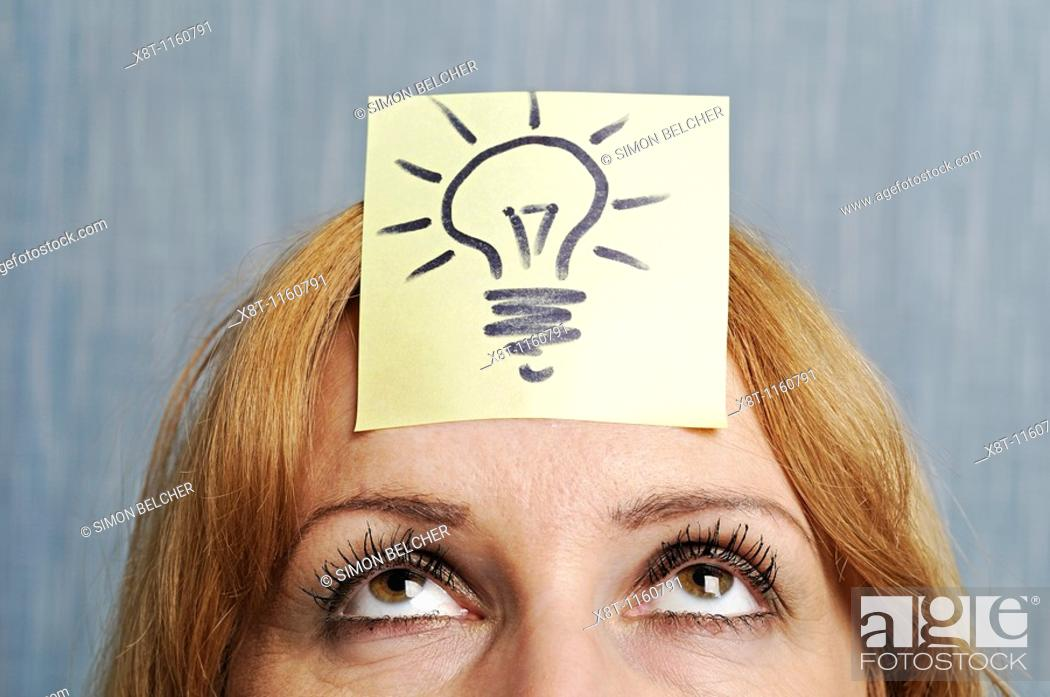 Stock Photo: Ideas, Woman with a Drawing of a Lightbulb on Her Head.