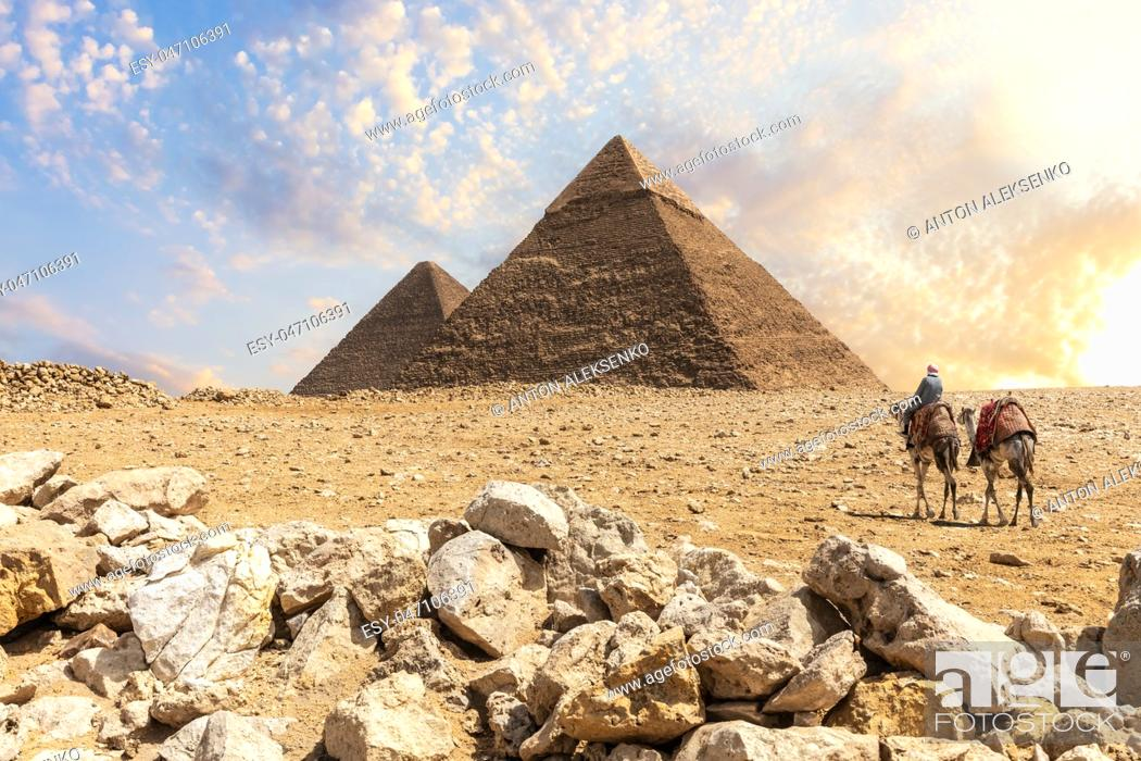 Stock Photo: The Great Pyramids in the desert of Giza with the bedouins nearby, Cairo, Egypt.