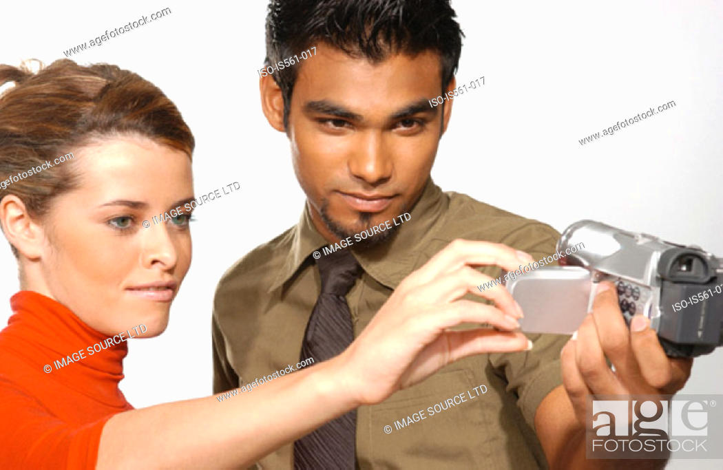 Stock Photo: People using video camera.