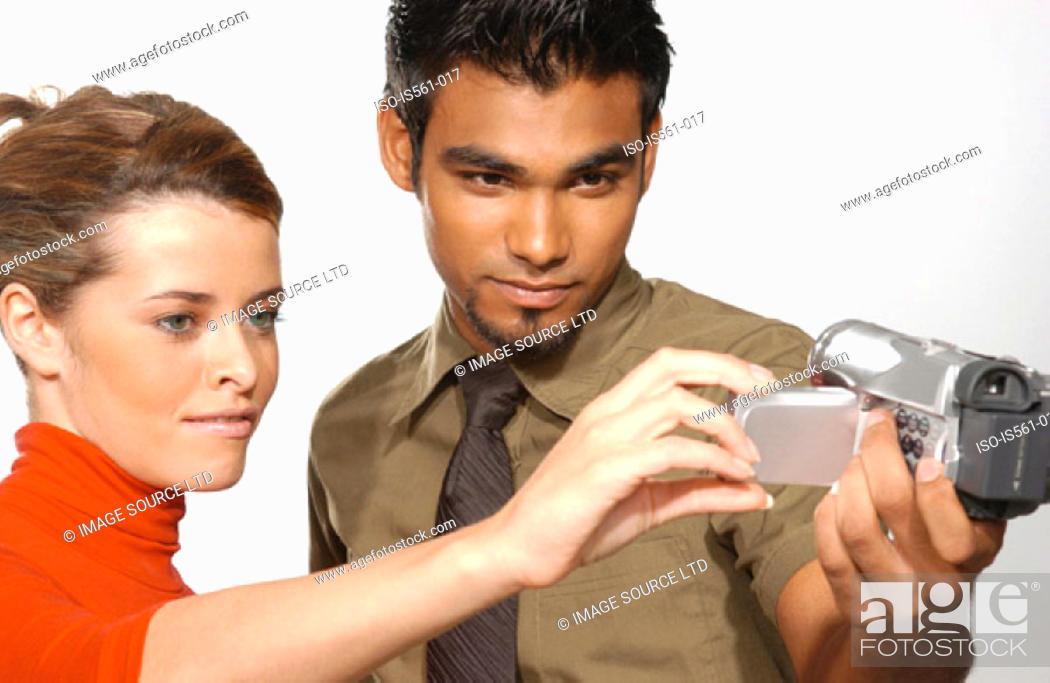 Stock Photo: People using video camera.