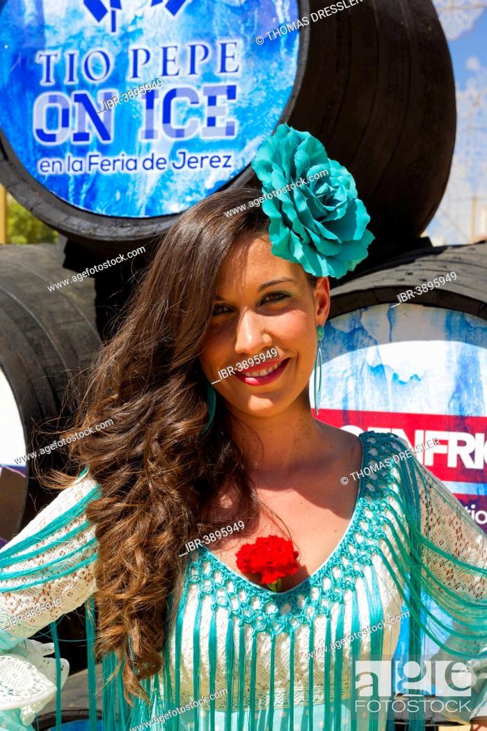 Stock Photo: Young woman wearing a gypsy dress at the Feria del Caballo, Jerez de la Frontera, Cádiz province, Andalusia, Spain.