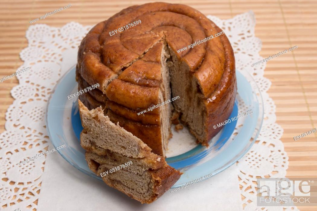 Stock Photo: Famous Portuguese folar cake presented in the table.