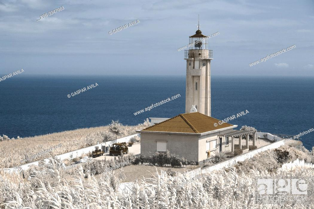 Stock Photo: Simulated infrared photo of the lighthouse of Ponta Garça. Sao Miguel island, Azores islands, Portugal.