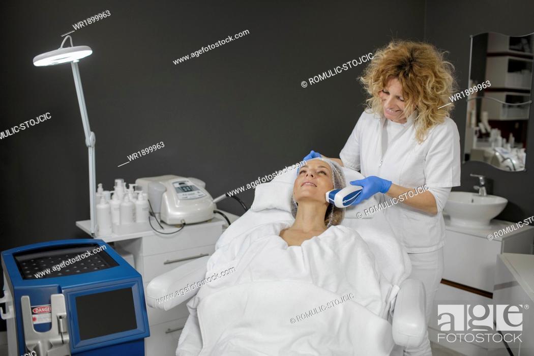 Stock Photo: Woman receiving beauty treatment.