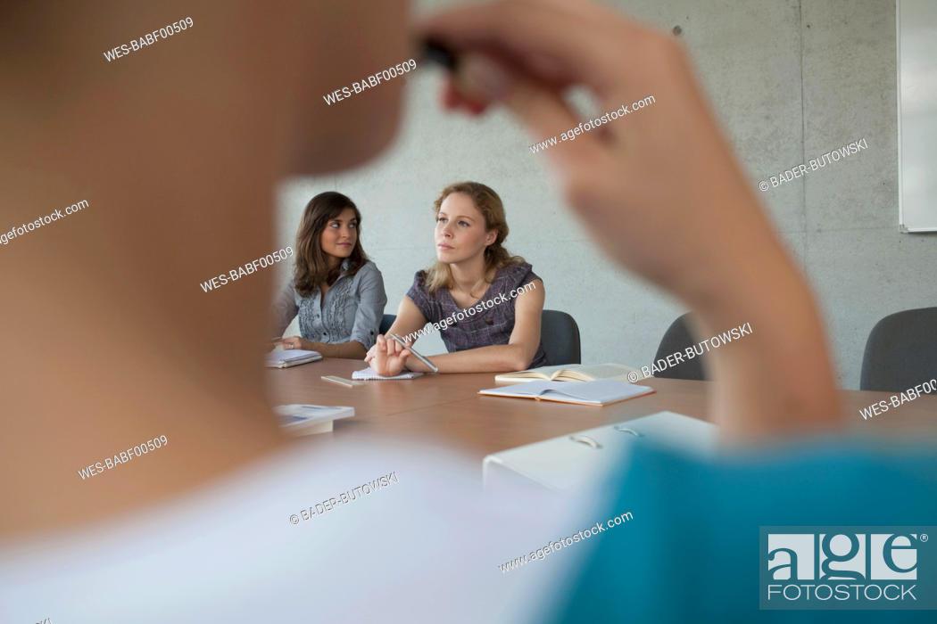 Stock Photo: Germany, Leipzig, University students studying together.