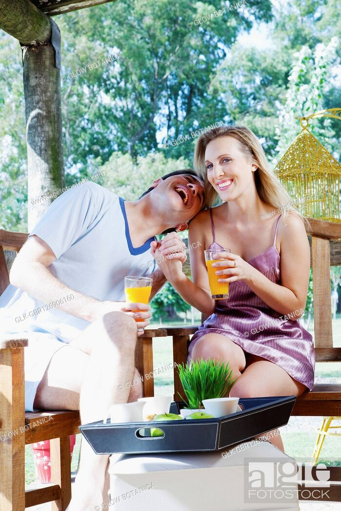 Stock Photo: Couple drinking orange juice.