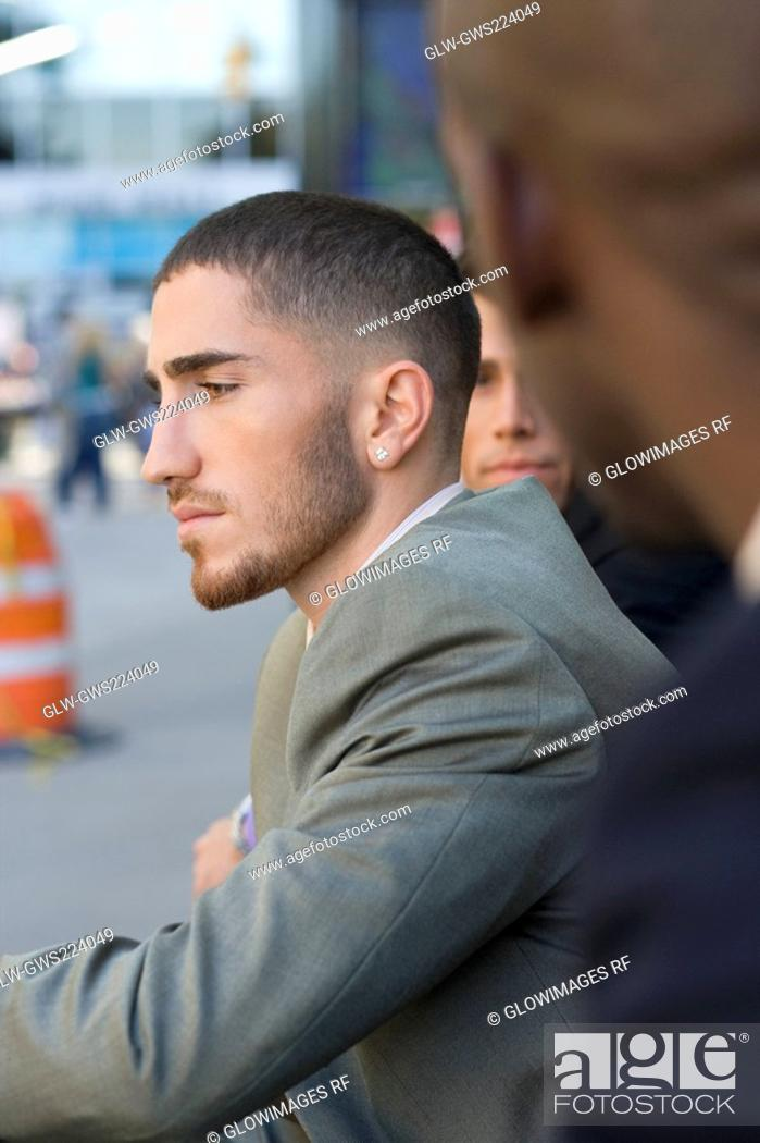 Stock Photo: Side profile of a businessman thinking.